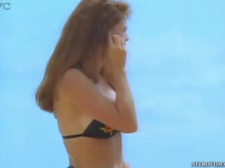 Alison Armitage In the Beach with a Sexy Black Bikini