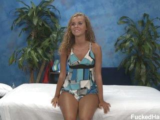 Cute tan skin girl Jessie in the massage room
