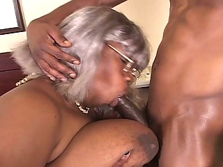 Bbw black grandma gets a piece of hunk cock