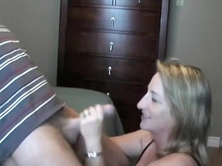 This lady loves to handle and suck her husband's cock.  She sucks it, puts on some flavored lube, and the strokes the shaft while she tonguing the tip in her mouth.  He finally cums in her mouth, moaning, and she swallows, with just a little bit of the cum dribbling out.