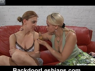 Lesbo gal gets widen and booty-fucked on the sofa by a strap-on armed honey