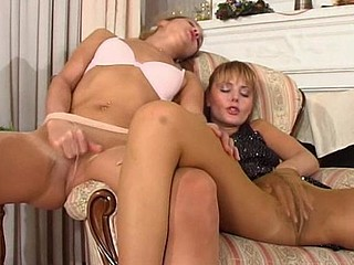 Strikingly beautiful gals in barely visible hose double their pleasure