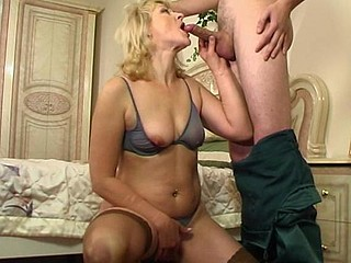 Oversexed aged blondie showing a kinky guy how to use his rock-hard shaft