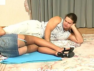 Upskirt gal in barely visible nylons getting down and immodest on the floor