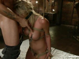 She's a blonde hottie and those big round boobs are asking for some attention. She gets all the attention she deserves as the guy puts clamps on her nipples and then fucks her mouth hard with his cock. Look at her gagging with that big dick while having a device that keeps her mouth opened, nice isn't it?