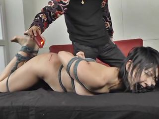 When it's about punishment and humiliation the sweet Nippon sluts are perfect for that. Here we have an old executor that really knows his job and proves it! He drips hot red wax on this beauty's butt and tits making her moan and screams frenetically. Her punishment just began, don't miss such a bad treatment!
