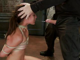 She gets her cute mouth fucked hard by this guy's erect penis, he drills her throat and uses her body like a sex toy having no respect for her, just the way she deserves it. After fucking her roughly the executor lays her down blindfolded with duct tape then plays with her sexy butt, grabbing it firmly. Being humiliated only makes this bitch hotter and she salivates thinking about that cock that he just gave it to her.