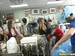 Lucky getting three chicks at once. Watch how happy he looks as all these babes are surrounding him and ready to get laid for money. All of these girls are showing their nice tits to him and he is playing with them happily. One babe starts sucking his cock while he is sucking the blonde's nipples.