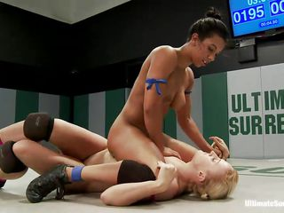 Blonde slut Dylan is wrestling naked with her brunette bitch Sophia and becomes tired after a while. The brunette improves the opportunity and gets over her, starting to kiss her neck and nipples. The blonde escapes from the clutch but gets caught again and has her pussy tickled. Watch a total domination!