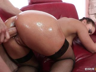 Watch her oiled ass as she takes a huge dick in her big wet vagina. This brunette slut has big tits and a very sexy ass and this guy loves to oil it. She gets her ass fucked hard from behind, will she receive some hot jizz as a reward?