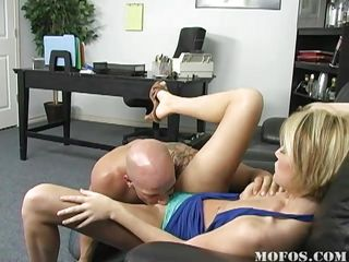 Bartender Riley is only 18, and busted by an undercover vice cop. He's going to arrest her unless she can convince him to forget it, and decides to fuck him. After getting her bald pussy licked and fingered,  he dips his nightstick deep in her, then bends her over the couch to do a more thorough search.