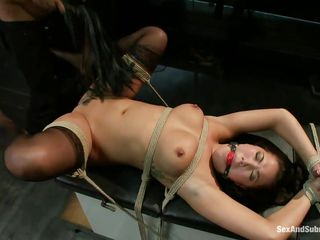 She's a brunette asian bitch that the guy tied on a table and now he's having fun with her! Her big natural breasts with metal clamps on them are bouncing nicely as he drills her cunt with his penis and that pretty mouth of her look great ball gagged. Wonder if the guy will keep on fucking her pussy and then cum in it?