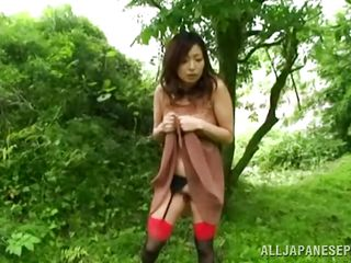 Nature loving Nippon cutie is receiving her dose of wilderness! This cute bitch has her hands tied on a tree branch and gets roughly fucked from behind. Her moans and screams won't help her because there's nobody around. Look at that sweet snatch being rubbed with a vibrator and then drilled hard.
