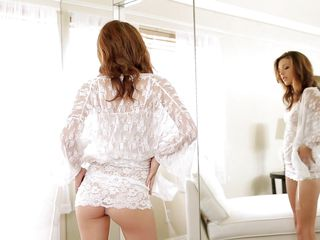 She looks at herself in the mirror and starts being horny. Who can blame her, in the end she's a hot chick and the white dress fits her damn good. The beauty slowly undresses, takes off her panties and spreads her legs to rub her shaved, pink pussy. This bitch needs a big hard dick to be completely satisfied!