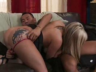 Busty blonde with ass tattoo gets her minge licked by tattooed hunk