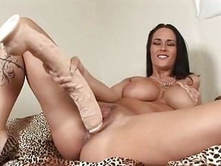 Enormous chested brunette hair sticks monster sex-toy up her shaved taco