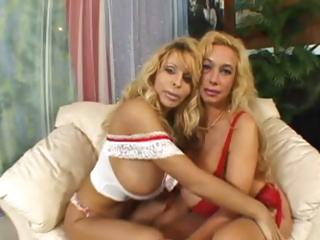 Two horny blonde lesbians caressing the massive tits and fucking with a double dildo